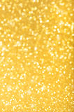 Sparkle background. Highlighted golden sparkle background for Christmas royalty free stock images