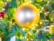 Sparkle ball on artificial pine christmas tree Stock Image