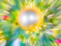 Sparkle ball on artificial pine christmas tree Royalty Free Stock Images