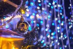 Sparkle ball hang on the fake pine Christmas tree Royalty Free Stock Photos