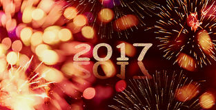 Sparkle and bokeh New year  firework background with  written  2017 Royalty Free Stock Photography