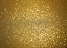 Sparkle bright glittering golden abstract background Stock Photography