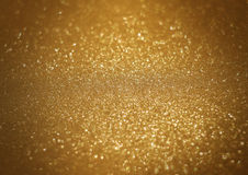 Sparkle bright glittering golden abstract background Stock Image