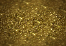 Sparkle bright glittering golden abstract background Stock Photos