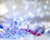 Sparkle Christmas background with decorations. Nestled in snow on bokeh lights and stars Stock Image