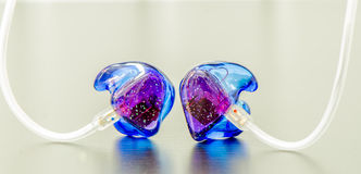 Sparkle in-ear monitors Royalty Free Stock Images