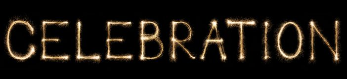 Sparkle firework written text celebration on black background. Celebration text made from burning sparkles on black background. Shiny festive party firework font stock photography