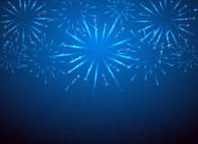 Sparkle fireworks on blue background Stock Photography