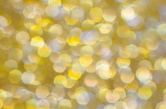 Sparkle and glitter gold yellow background. Sparkle and glitter golden yellow abstract background. Celebrate holiday or special occasion with this twinkling Stock Photos