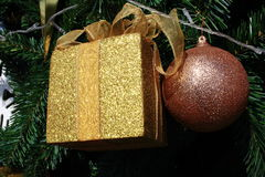 Sparkle Golden Present Box And Red Ball Hanging On Christmas Tree Stock Image
