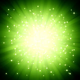 Sparkle green light burst with stars Stock Photo