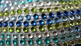 Sparkle and stripes. Background of blue, green and aqua sparkly jewels Royalty Free Stock Image