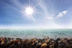 Sparkle sun above a sea Stock Images