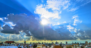 Sparkle sun and clouds royalty free stock photo