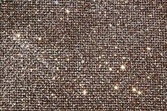 Sparklen av försilvrar brunt tyg Royaltyfria Foton