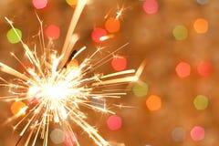 Sparkler и цветастая запачканная предпосылка Стоковые Фото