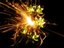 Sparkler. Holiday multicolored stars sparkler closeup Stock Image