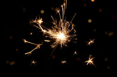 Sparkler. Hand held sparkler on black background Royalty Free Stock Photos