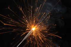 Sparkler. Abstract image of burning sparkler with dark background Royalty Free Stock Images