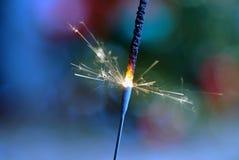 Sparkler. Burning sparkler front christmas tree Royalty Free Stock Photos
