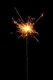 Sparkler. Burning christmas sparkler isolated on black background Royalty Free Stock Image