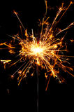Sparkler. Burning christmas sparkler isolated on black background Stock Photos