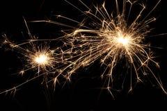 SPARKLER. Macro of sparkler/firework at night Stock Photo