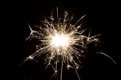 Sparkler. One little Christmas sparkler on a black background Royalty Free Stock Photography