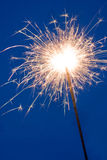 Sparkler. Before blue background (ambient light Royalty Free Stock Image