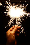 Sparkler. Hand holding a sparkler - symbolic image Royalty Free Stock Images