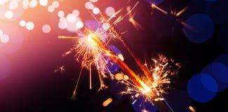Sparkler against defocused background Stock Photo