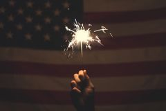 Sparkler and American flag Stock Photo