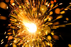 Sparkler or Bengal light. Sparkler close up with sparkles Stock Photo