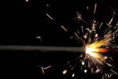 Sparkler on black background. The picture shows a sparkler on black background royalty free stock photos