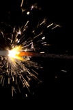 Sparkler on black background. The picture shows a sparkler on black background stock photos