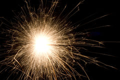 Sparkler on black background. The picture shows a sparkler on black background stock image