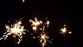 Sparkler on black background. Clouse up stock footage