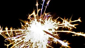 Sparkler on black background stock footage