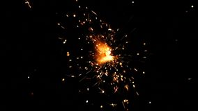Sparkler on a black background in slow motion Chroma key. Burning Bengal fire on a black background in slow motion Chroma key stock video