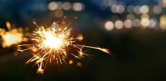 Sparkler with blurred bokeh light. Background royalty free stock photo