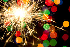 Sparkler and bokeh Stock Photography