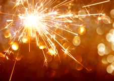 Sparkler on bokeh background close up Stock Images