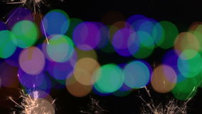Sparkler burning on blurry backgrounds stock video footage