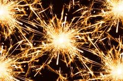 Sparkler. Burning sparkler closeup on black background Royalty Free Stock Photo