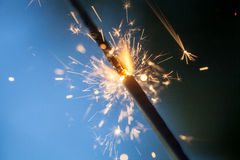 Sparkler. Burning and glowing in the dark Royalty Free Stock Photography