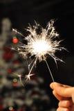 Sparkler for christmas. Sparkler flooding light the christmas Eve Stock Image