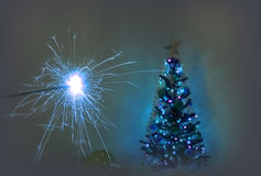Sparkler and christmas tree Royalty Free Stock Photography