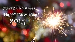Sparkler and christmas tree stock video footage