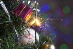 Sparkler on a Christmas tree Stock Photo