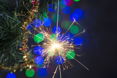 Sparkler on a Christmas tree Royalty Free Stock Photo